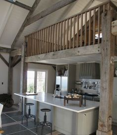 Loft above kitchen. Love the huge island/bar!