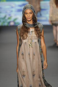 Tribal and girly at Anna Sui's #NYFW show - love the headscarf.  and is that a vest with the dress?  I think it is, and I love that too.