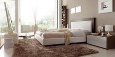 Dormitorio en blanco combinado con madera. Cabecero en madera con blanco