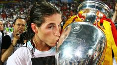 Sergio Ramos kisses the silverware after Spain triumph at UEFA EURO 2008
