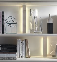 Ample shelf space with built-in lighting in the smart wall unit system