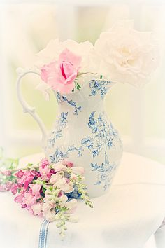 Flowers in blue and white pitcher