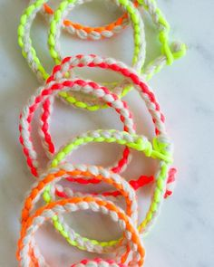 free bracelet pattern from Purl Bee. I'd go for more natural colors; they'd look terrific layered around a watch.