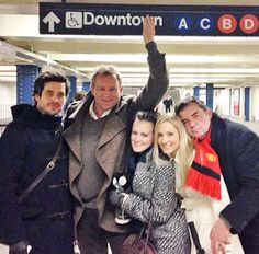 The cast of Downton Abbey in New York City. LOVE Hugh covering up the w!