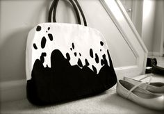 If you know me, you know why I like this. Too bad my 17 inch laptop probably won't fit in it.  MOO <3     Black  and white spotted bag by chebran on Etsy, $95.00