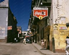 Coca Cola Signs Streets Puerto Rico 1940s 8x10 Reprint Of Old Photo Here is a neat collectible from San Juan, Puerto Rico in the 1940s, featuring a street lined with Coca Cola signs. This is an excell