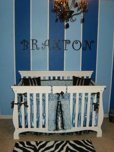 Blue-on-blue stripes make a chic boy's #nursery.  #blue #stripewall