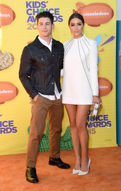 Olivia showed off her gorgeous gams in a white-hot minidress with long sleeves and metallic detail. But her best accessory was her boyfriend, Nick Jonas. Source: Getty / Jason Merritt
