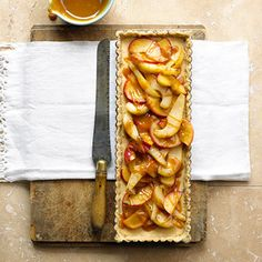 Purchased pecan shortbread cookies are the crust's main ingredient in this recipe. Add cream cheese, apples, and pears and drizzle with caramel topping for a scrumptious dessert.