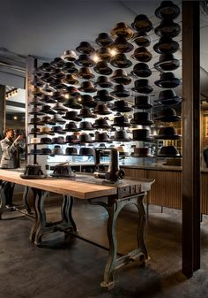 What a glorious vintage-industrial style space! LOVE that work table, and the hat display reminds me of the All Saints Spitalfields sewing machine window! Optimo Hat Shop, Chicago