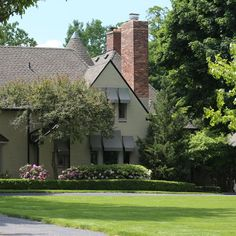 This handsome house on Grosse Ile, by the esteemed architect Wallace Frost, looks out across the Detroit River with Stony Island on one side of its