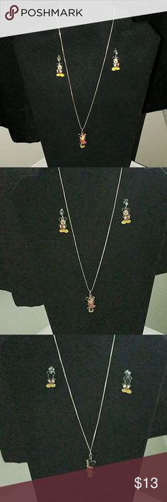 Necklace and earrings Minnie Mouse necklace on a silver chain and Mickey Mouse earrings this is a great set good condition and good quality Jewelry Necklaces