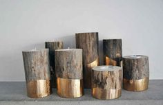 These gold-dipped log candle holders.