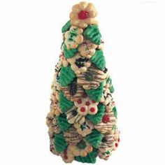 Holiday guests can pick a cookie treat right off this festive tree. Create a delicious centerpiece by attaching decorated Spritz cookies to foil-covered craft cone with melted candy. Great decoration and dessert.