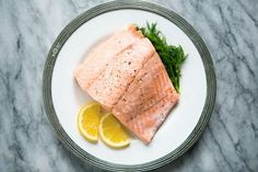 Poached Salmon from Simply Recipes - works great with frozen fillets too, just poach a little longer.  Perfect for weeknight.