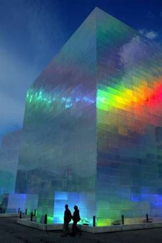 """""""A couple walks past 'Quantum Field- X3', an art installation by Japanese artist Hiro Yamagata, in Bilbao, northern Spain, January 27, 2005. The work, which is displayed outside the Guggenheim museum, consists of two giant cubes made up of holographic panels that reflect and refract visible light frequencies. REUTERS/Vincent West"""" -- See the daytime version of this holographic cube here: http://pinterest.com/pin/175218241722347967/"""