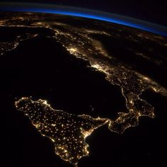 """Astronaut Reid Wiseman shared this image of Earth showing Italy at night from the International Space Station tweeting """"I looked on in awe and was rendered speechless by so much beauty."""""""