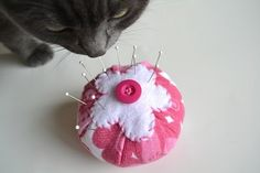 Kitty loves the pincushion too! DIY pincushion from recycled sweater.