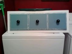 Upcycled dresser drawer fronts I painted and distressed now towel holder for my bathroom Love it!