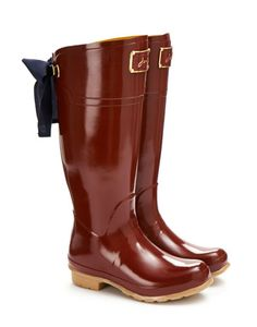 Joules EVEDON Womens Premium Rain Boots, Red. Are you feeling splashy go lucky? In our latest addition to our Premium Rain Boots Collection, you should be! This Rain Boots gently falls away at the back and the addition of a luxurious ribbon only increases its elegance.