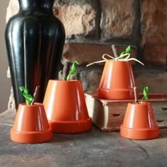 Create a whole family of pumpkins using terra cotta clay pots!