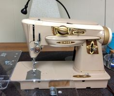 I grew up with this one...  http://quiltville.com/sewingmachines/singer500a1.JPG