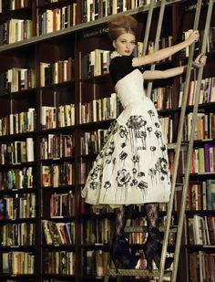 Model on library ladder looking for books. Photographed by Olivia Graham. The Gloss, Olivia Graham is an American photographer based in New York. She specializes in fashion photography and. Sexy Librarian, Librarian Style, Disney Couture, Night Circus, Celebrity Weddings, Editorial Fashion, Fashion Photography, Photography Lessons, Editorial Photography