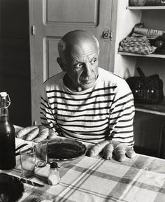 Picasso in stripes at a cafe (with bread hands)