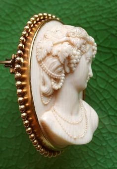 Materials: ivory, goldfilled brass  Date: 1840-1860  Origin of the cameo: France  Size: 2 1/2 x 2