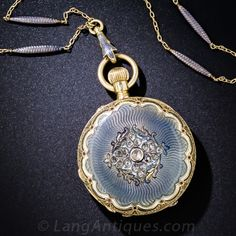 18K Enamel and Diamond Demi-Hunter Pocket Watch and Chain, his nineteenth century treasure from the land of chocolates and cuckoo clocks (as well as the world's finest timepieces), by A. Golay - Leresche & Fils of Geneve and Paris, is exquisitely ornamented in every nook and cranny with shimmering steely blue guilloche enamel outlined in black and white, glittering rose-cut diamonds and masterful hand engraving. The watch measures 1 and 3/8 inches across; the matching chain measures 22…