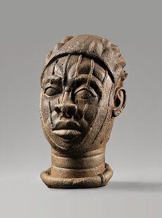 Head   12th–15th century Geography: Nigeria, Ife Culture: Yoruba peoples Medium: Terracotta Dimensions: H.: 7 1/2 in. (19 cm) Classification: Ceramics-Sculpture Credit Line: Ethnologisches Museum, Staatliche Museen zu Berlin (III C 27527)