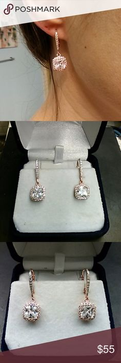 5.25ctw AAA Diamonds 14k Rose Gold / 925 Absolutely gorgeous earrings. 5.25 carats total weight man made White Diamonds. 14k rose gold over solid 925 sterling silver earrings. estate 925 Jewelry Earrings