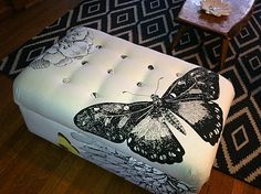 DIY- How to Recover Your Ottoman, this One was Recovered with a Fabric Shower Curtain From West Elm.