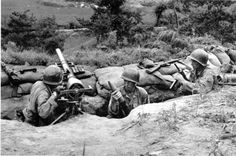 Unidentified American soldiers man a 75mm recoilless rifle covering a vital road somewhere in South Korea on July 31, 1950, during the Korean War. (AP Photo)