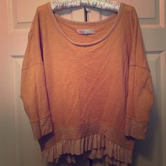 Free People Beach Sweater This Free People Beach sweater is orange/tannish in color. The sleeves are quarter length and it has a ruffle trim around the bottom. It is a size medium. The neck is wider and can go off shoulder if desired. There are slits on each side as shown in the picture. It is 100% cotton and machine washable. Great condition! ✨contact me if interested✨ Free People Sweaters