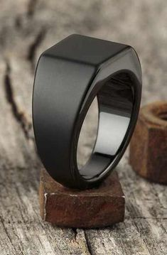 """Made from tungsten, the Lourd is by far our weightiest ring, and fittingly takes. Made from tungsten, the Lourd is by far our weightiest ring, and fittingly takes it's name from the French word for """"heavy."""" Based on a classic school. Jewelry Rings, Jewelery, Gold Jewelry, Jewelry Quotes, Black Jewelry, Jewelry Stand, Opal Jewelry, Wooden Jewelry, Gold Bangles"""
