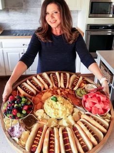 Charcuterie/Cheese Board Archives - Reluctant Entertainer birthday dinner ideas meals Epic Hot Dog Board for Twelve Party Food Platters, Food Trays, Catering Platters, Party Food Bars, Catering Display, Party Trays, Catering Food, Appetizers For Party, Appetizer Recipes