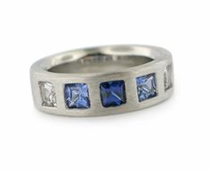 -a very special wedding band in palladium with custom cut sapphires by Catherine Iskiw Designs