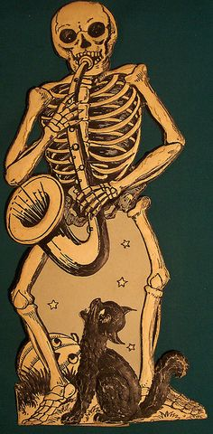 Skeleton with a sax, german diecut. I don't think I've ever seen this one. I imagine it's pretty rare.