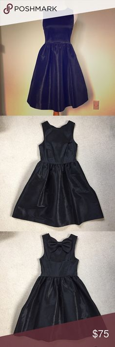 CeCe Cocktail Dress Gorgeous!!! Only worn once, EUC! CeCe by Cynthia Steffe black cocktail dress in fit and flare style with bow detail on back. Side zipper and POCKETS!!! cece Dresses