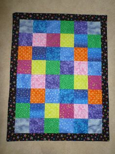 Brightly Colored Star Themed Baby or Cuddle Quilt! Multicolor Star Cotton Fabrics with Black with Multicolor Star Border & Blue with Silver Star Back! JGless Designs!