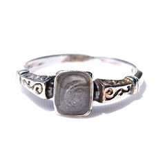 About this piece:  On the top of this sophisticated sterling silver ring sits a small amount of hardened ashes/cremations. The opening is a small