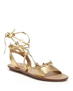 Loeffler Randall has us starstruck with flat sandals that are out of this universe.   Metallic vachetta leather upper, leather lining, rubber sole   Made in Brazil   Open toe; wrap ankle strap with st