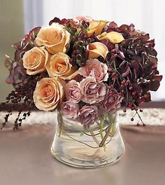 Steve - A floral arrangement like this but on a bigger scale with a crystal vase would work nicely!