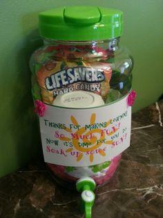 End of year gift: lemonade, beach ball, lifesavers and sunscreen inside of drink dispenser.
