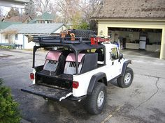 AEV Brute with custom AEV rack by - same white Jeep Brute with the trailer.