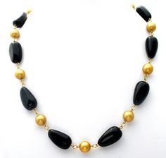 """Designer Couture Jewelry Necklaces - This is a gold tone link chain necklace with black and gold lucite beads. It is 23"""" long, with the largest beads measuring .63"""" wide. This necklace is in excellent"""