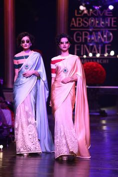Half satin n half net saree with embroidery on the pleats.. But with a boat neck striped blouse.. The same was worn by Kangna Ranaut..