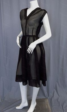 Vintage sheer dress of textured black organza, gathered at shoulders and waist with full skirt, cute collar, and cap sleeves circa 1950s from Recursive Chic @ recursivechic.com