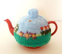 Hand knitted flowers and button tea cosy | Fantastic Supermarket